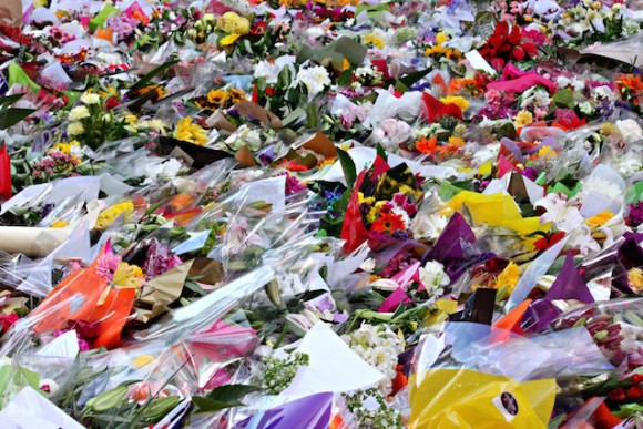 Sydneysiders pay tribute with an ocean of flowers to the two hostages,  Katrina Dawson, 38, and Tori Johnson 34, who died during the Lindt Cafe siege held by Man Haron Monis.  Photo: Marine Raynard